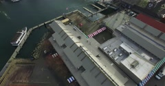 Winding aerial back sweep granville island with seagulls Stock Footage