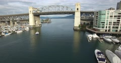 Aerial flight under and through burrard bridge Stock Footage