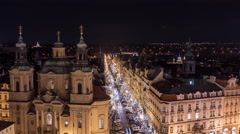 Night Christmas time lapse of St Nicholas Church in Prague Stock Footage