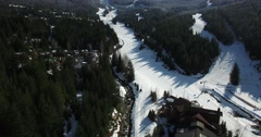 Aerial birds eye of skier along snow creek Stock Footage