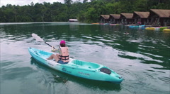 Khao Sok Boat,  Excited Woman, Canoe, Red Hat, Boat Houses, Side to Front View Stock Footage