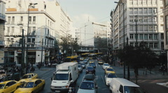 Athens aerial gimbal driving downtown entering Omonia sq back view Stock Footage