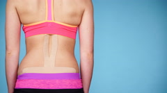 Woman with medical kinesio taping on back 4K Stock Footage