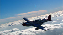 P-51 Mustang Red Tail Air to Air Backlight Stock Footage