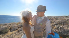Beautiful beach marriage. the bride and groom against the blue sea - stock footage