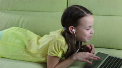 Stock Video Footage of Emotional little girl talking on Skype at laptop