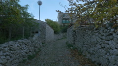 View of a stone street and stone buildings on Krk Island Stock Footage