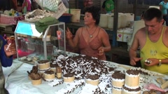 Couple in market stall in Belen sells hand rolled cigaretts Stock Footage