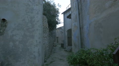 Narrow street between old buildings with traditional architecture on Krk Island Stock Footage