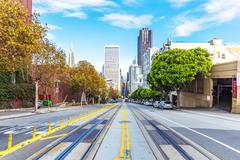 City road with cityscape of San Francisco in cloudy sky Stock Photos