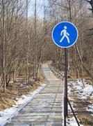 Blue pedestrian sign zone road  . - stock photo