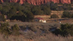 Single house at base of mountain Stock Footage