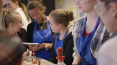 4K Group of students working together in school science class - stock footage