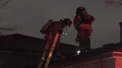 Firefighters on Roof of Home Stock Footage