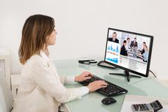 Young Businesswoman Video Conferencing On Computer In Office Kuvituskuvat