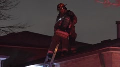 Firefighter Climing Down Ladder from roof Stock Footage