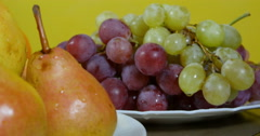 Dolly shot from grapes to pears, fresh fruits extreme close up. Stock Footage