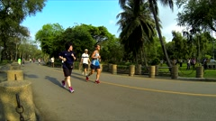 BANGKOK - People running in the morning in park. 4K resolution speed up - stock footage