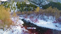 Aerial fly up river in winter Stock Footage