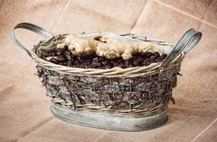 Dried rosehips and ginger arranged in the wicker tin basket, healthy lifestyl Stock Photos