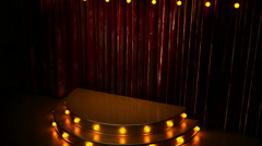 Red curtain stage with golden podium and lights Stock Footage
