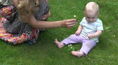 Baby explore flowers lawn Stock Footage