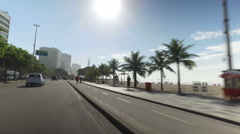 Vehicle shot of people on Ipanema Beach in Rio de Jnaeiro Stock Footage