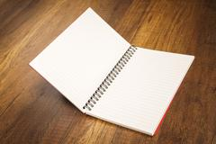 Note book on a wooden desk - stock photo