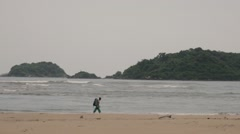 Backpacker walking alone on the beach - stock footage