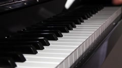 Man playing the piano Stock Footage