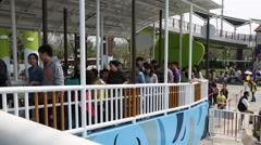 People queuing in Taipei Children's Amusement Park Stock Footage
