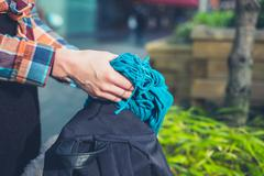 Hands of young woman opening rucksack - stock photo