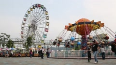 Wave Swinger and ferris wheel in Taipei Children's Amusement Park Stock Footage