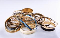 Lots of various golden bracelets Stock Photos