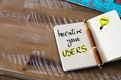 Written text INCENTIVE YOUR USERS - stock photo