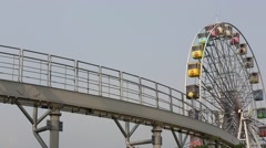 Monorail and ferris wheel in Taipei Children's Amusement Park Stock Footage