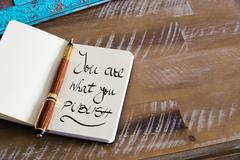 Handwritten text YOU ARE WHAT YOU PUBLISH - stock photo