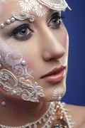 Gorgeous woman with extravagant bridal make up - stock photo