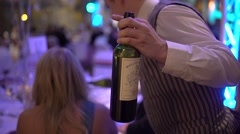 Waiter holding and also pouring bottle of wine Stock Footage