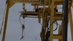 The yellow wheel from the ski lift working and spinning. Stock Footage