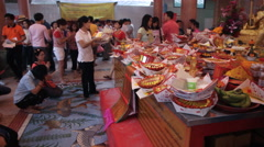People offering prayers to celebrate the Chinese New Year festival. - stock footage