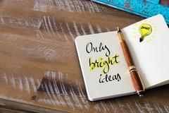 Written text ONLY BRIGHT IDEAS - stock photo