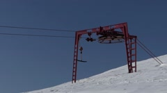 The red wheel from the ski lift working and spinning. Beautiful background. Stock Footage