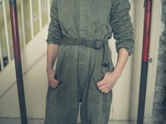 Person in boiler suit in house undergoing renovations Stock Photos