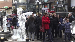 Crowd of people enjoying the ice sculptures on display at the 11h Annual Icefest Stock Footage