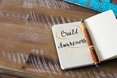 Handwritten text BUILD AWARENESS - stock photo
