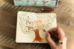 Written text BE YOU BELIEVE IN YOURSELF - stock photo
