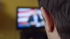 BACK VIEW: A young man watch TV at home - stock footage