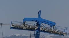 The blue bar of chair lift station on ski resort working and spinning isolate. Stock Footage
