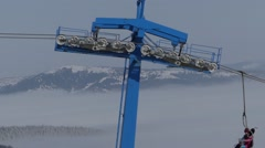 Chair lift on ski resort. Transporting people to the top of mountain. Stock Footage